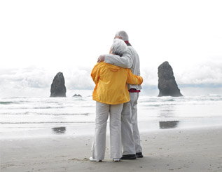 Older couple looking out to sea